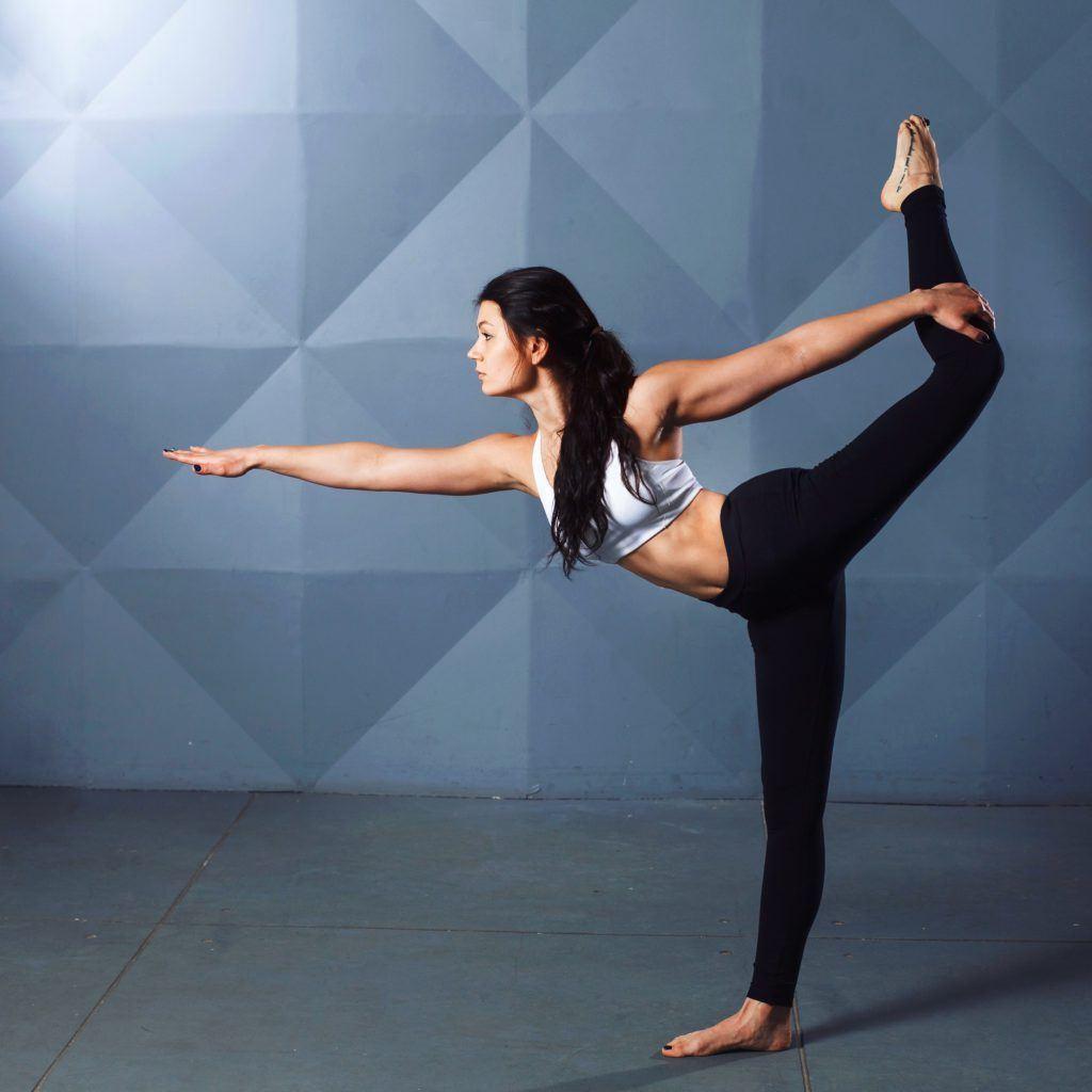 a women practicing a dancer pose
